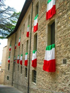 Flags on medieval homes in assisi