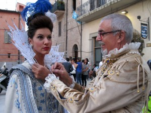 Tailor of the giotti rione adjusts splendid lace collar