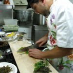 Alessandro young chef prepares wild fennel for pork roast