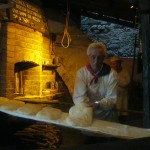 Fraporta-baker-making-focaccia-in-the-medieval-forno-of-the-terziere