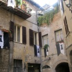Medieval-corner-of-Narni-with-Mezule-black-and-whitye-flags
