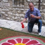 Antonio-keeps-the-flowers-fresh,-spraying-with-water