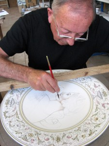 Master maiolica artisan at work