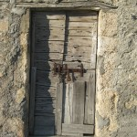 Old-wooden-door-of-an-abandoned-stall-in-Castelluccio