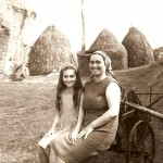 Chiarina and her daughter in front of haystacks, 1977