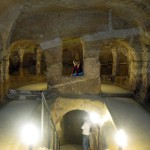 A-young-visitor-pauses-in-the-apse-of-the-medieval-underground-church