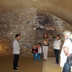 Daniele-tells-guests-about-the-largest-ambience,-used-for-secret-meetings-in-the-Middle-Ages
