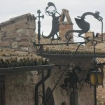 Artistic wonders in wrought iron frame this chimney