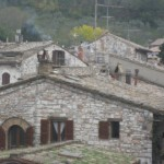Assisi rooftops are an array of artistic chimneys and woodstove pipes