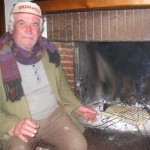 Peppe toasts bread for bruschetta in the fireplace