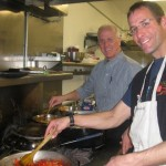 A cooking duo at the burners