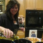 Diana adjusts the olive oil in our mushroom dish