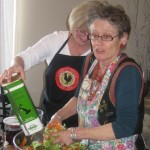 Mary adds the oil as we mix the salad, the Italian way