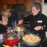 Paulette and Judie team on the pasta seasoning