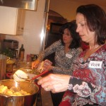 Vickie and Sharon team on potatoes and chicken