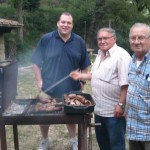 Americo grills meats for an American guest