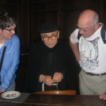 Brother Paul makes  a rosary for his guests