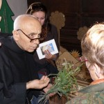 Fra Paolo shows guests plants he uses for the rosaries
