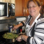 Kathy - a happy host at the stove