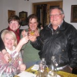 Olga and Americo toast with friends