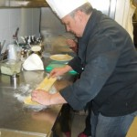 Chef Paolo folds the pasta dough for the cutting of fettuccine